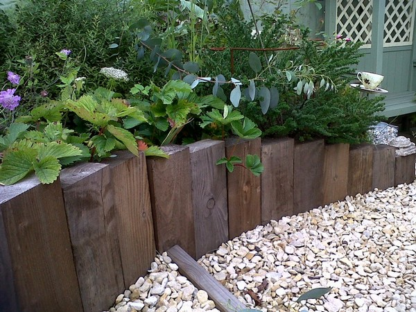 Creative Garden Edging Ideas how to do garden edging with leftover house tiles creative garden edging with dazndi Timber Garden Edging Ideas