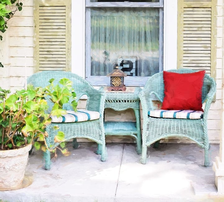 blue rattan garden furniture on the porch