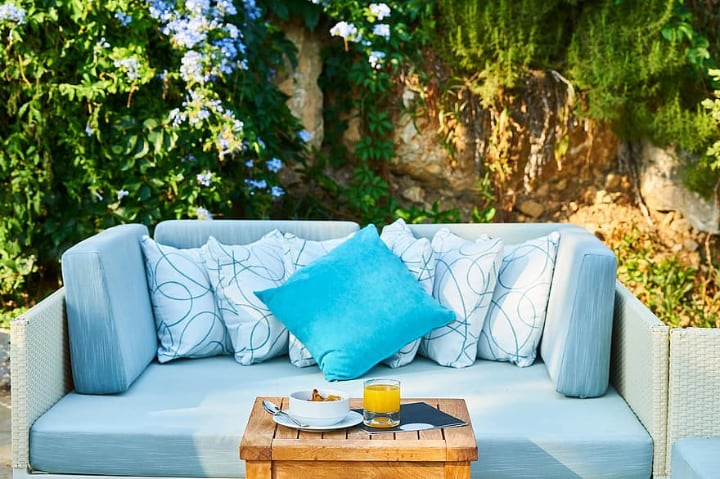 cozy rattan furniture in the garden