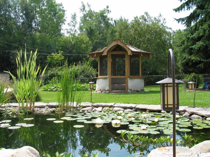 gazebo near an artificial lake