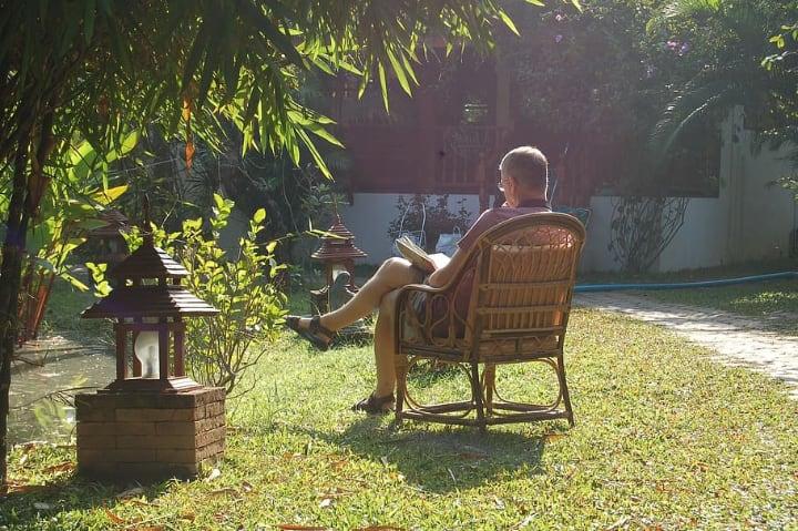 man reading under the sun