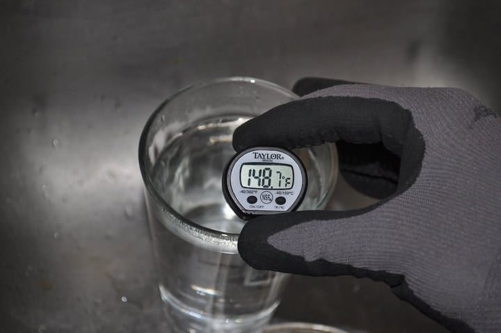 measuring water temperature on a kitchen thermometer