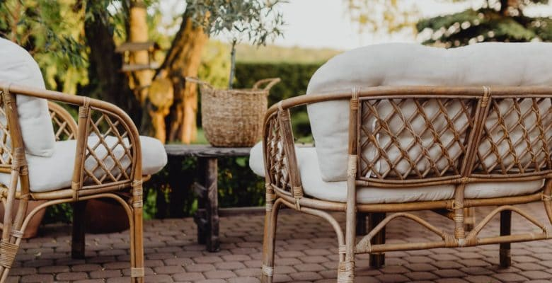 rattan furniture in the garden at sunset