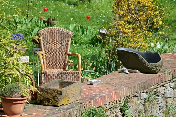 rattan garden chair with plants