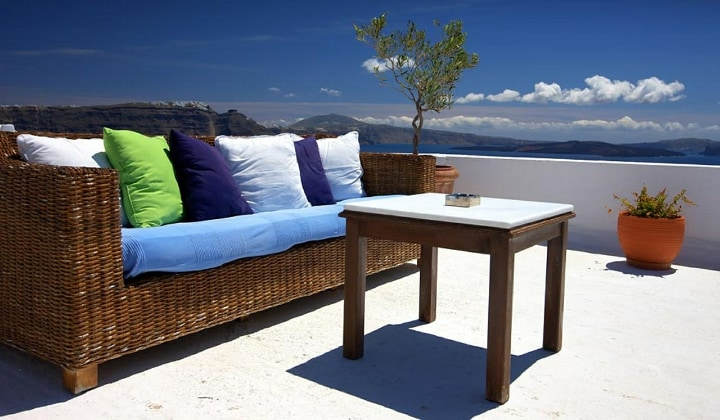 rattan garden furniture in a sunny balcony