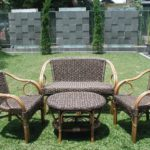 rattan garden furniture on grass