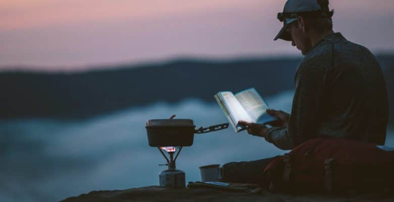 cooking using a camping stove in the mountain