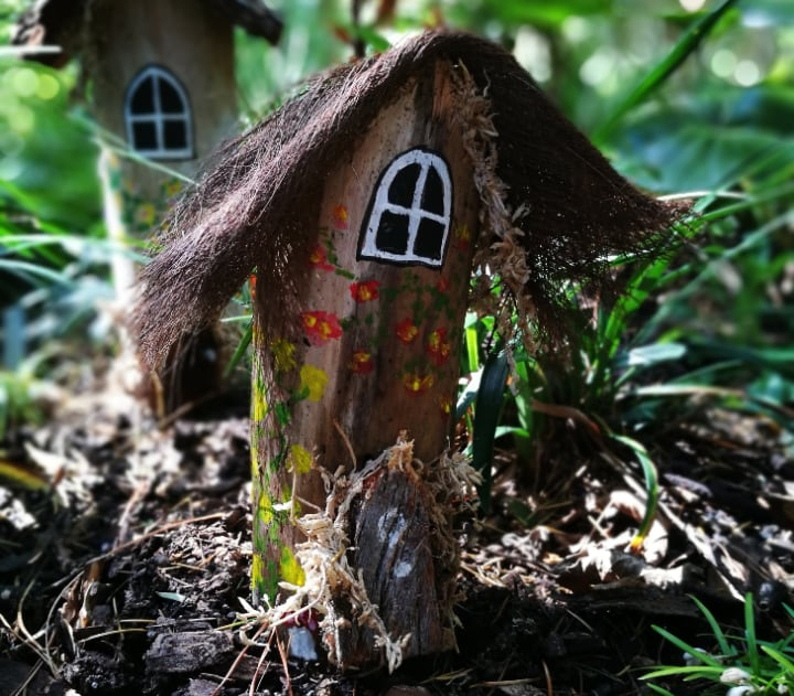 fairy garden houses amidst plants