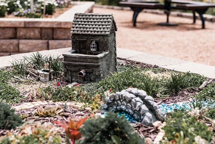 fairy garden with miniature house ad decorations
