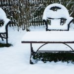 metal garden furniture covered in snow