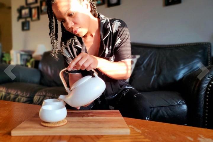 pouring tea on tea set