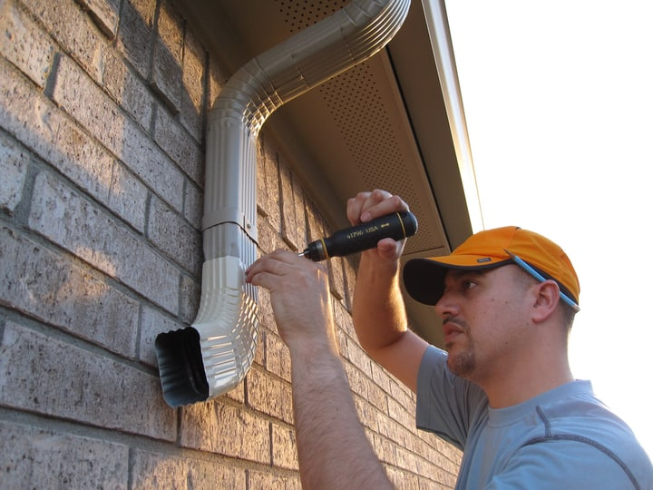 adjusting the downspouts