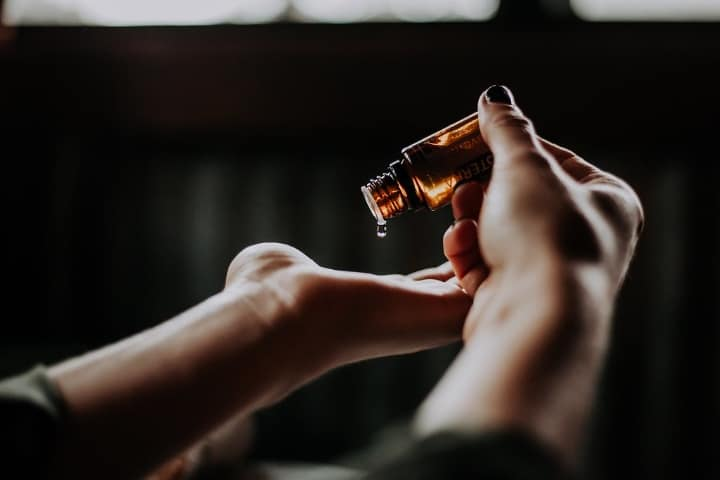 applying drops of bergamot oil