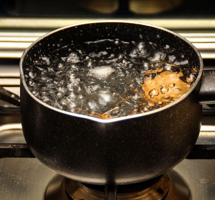 boiling water in a small pan