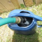 disposing rain water using a watering can