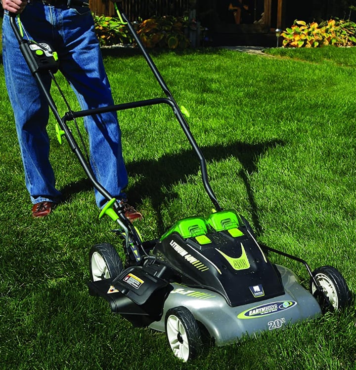 electric lawn mower in action