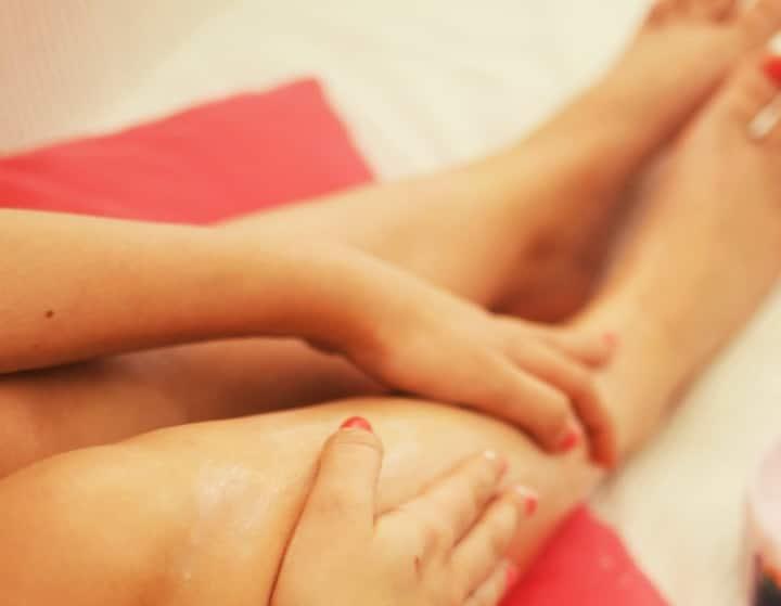 rubbing bergamot oil on feet and thighs