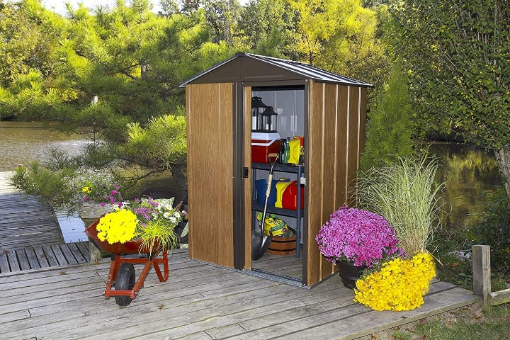 small garden shed with tools inside