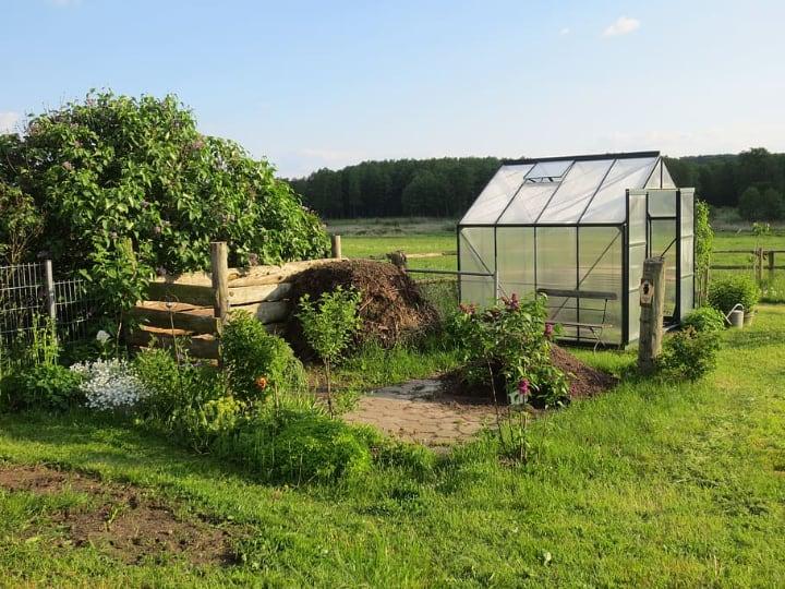 beautiful garden with a mini greenhouse