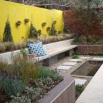 garden design with landscaping rocks greens and water feature