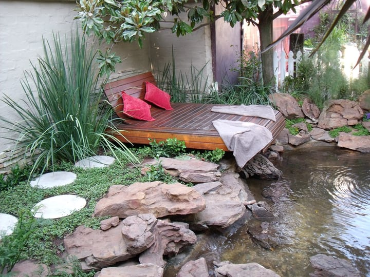 garden design with pond and bed