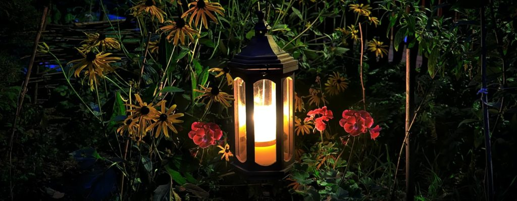 garden lamp post turned on at night