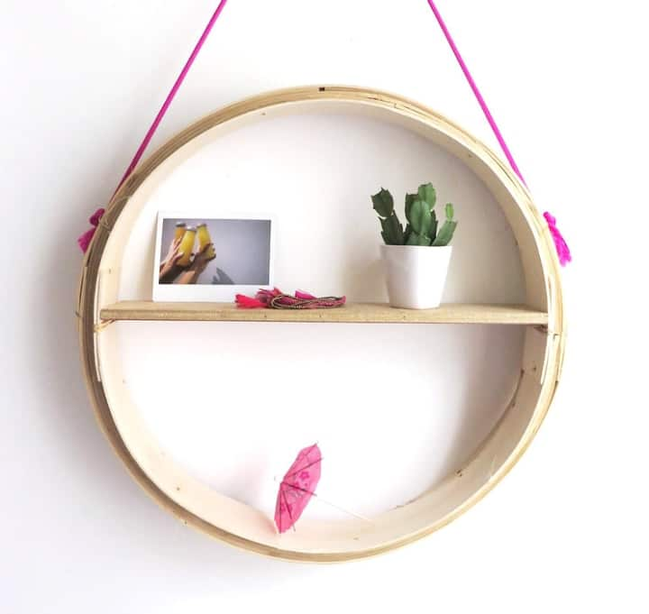round hanging wooden shelf with houseplant