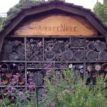 beautiful bees house in a flower garden