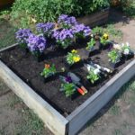 how deep raised garden bed should be
