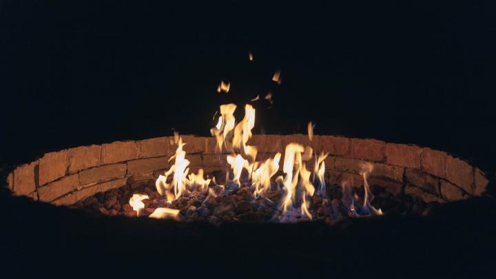 brick fire pit at night