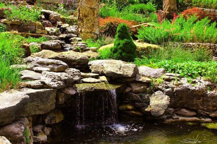 decorative garden rocks on pond