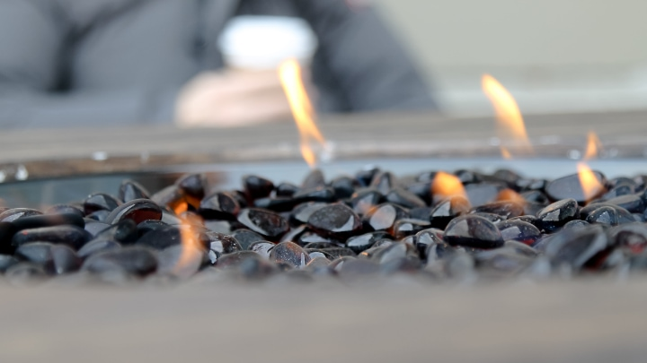 gas fire pit with black rocks