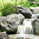 waterfall with rocks in the garden