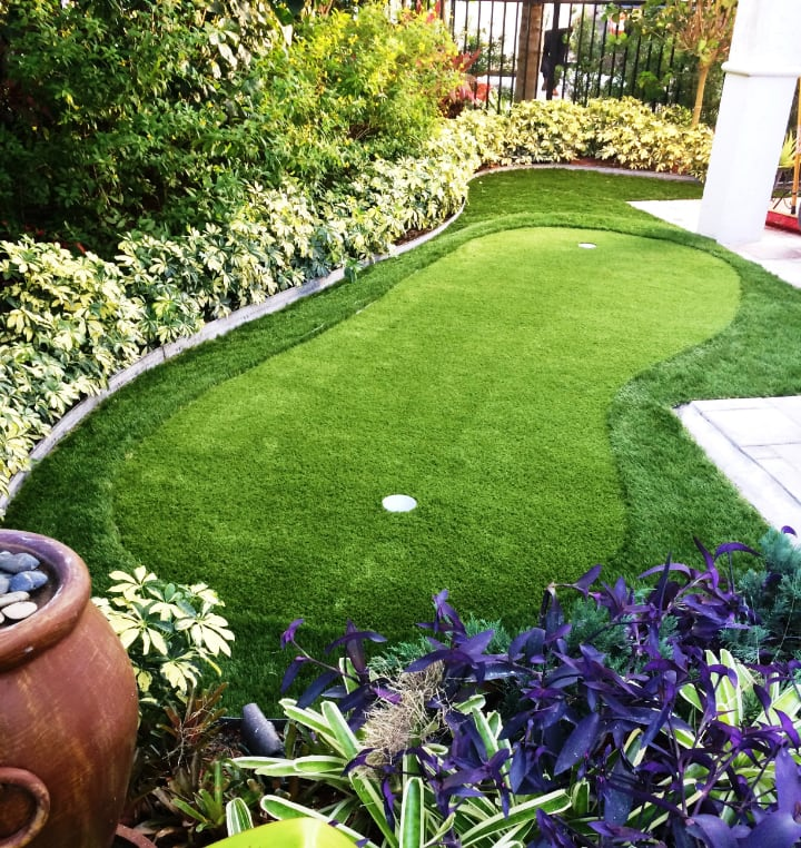 artificial grass for a low maintenance landscaping design for front lawn