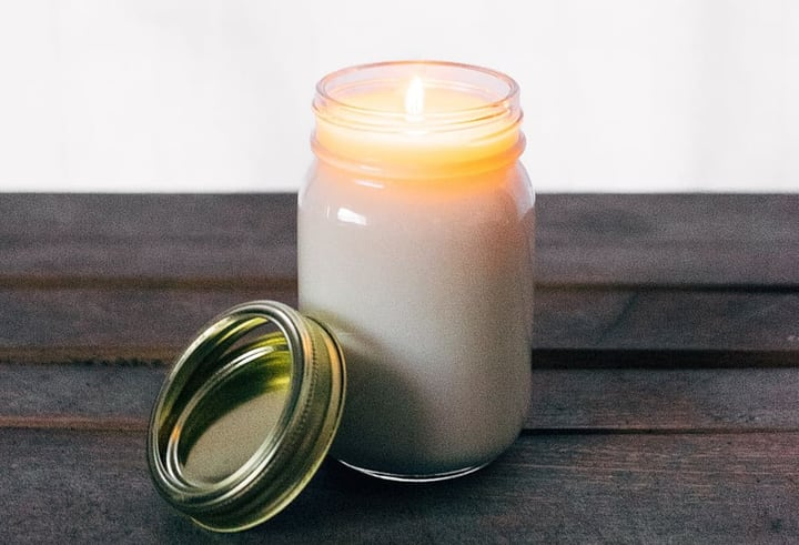 homemade lavender soy candle in a mason jar