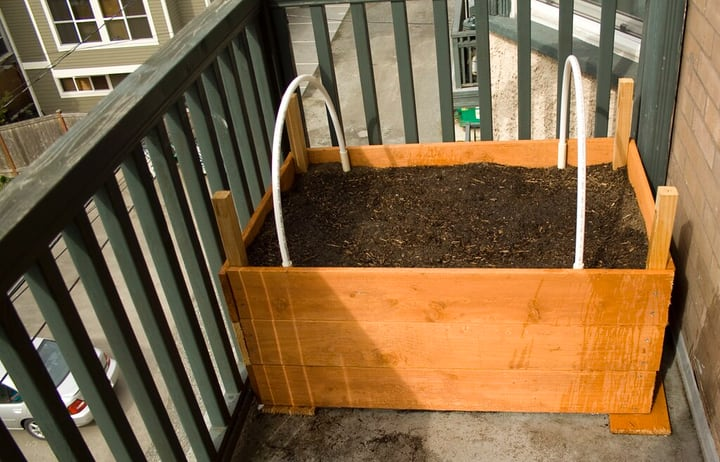 small balcony space with planter