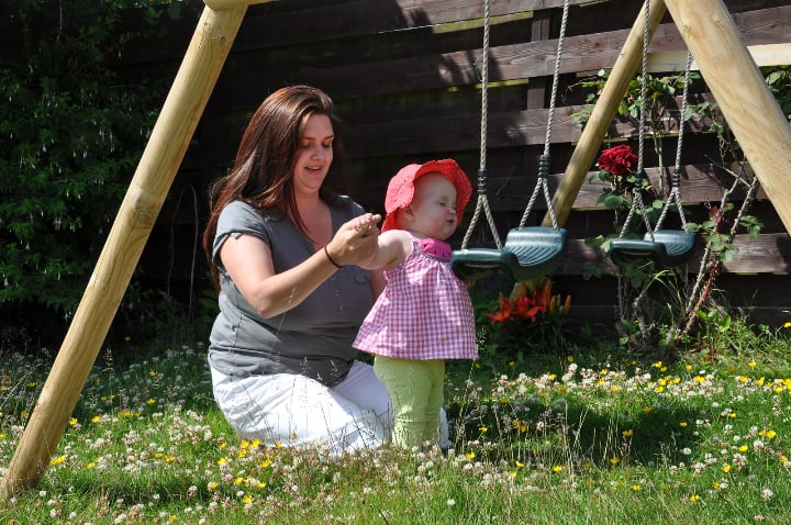 spending time in the garden swing with kids