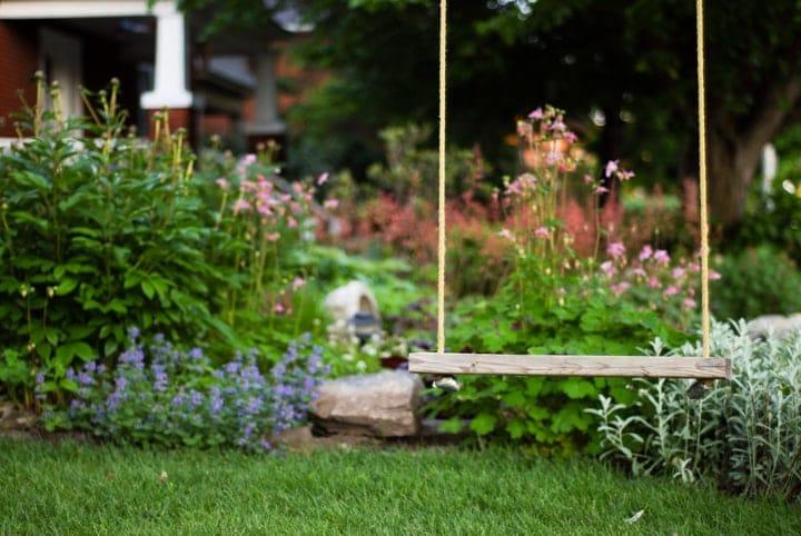 wooden swing in the garden
