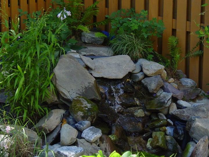 diy waterfall on pond