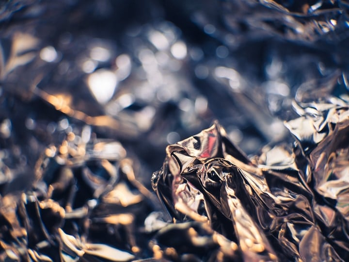 use foil to wrap trees and shrubs