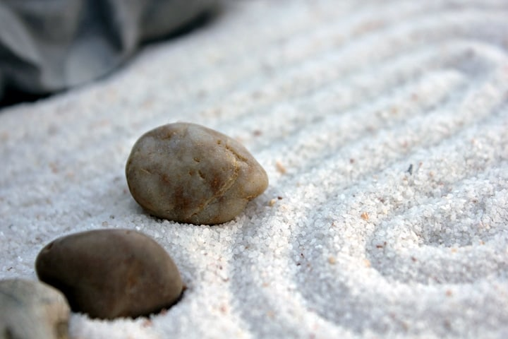 arranging rocks andsand on the zen garden