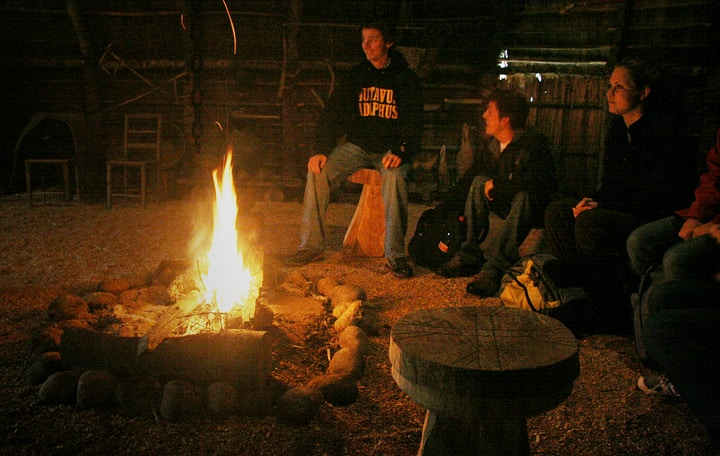 gathering in a firepit at night