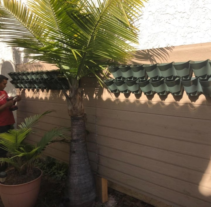 installing wall planters on wall
