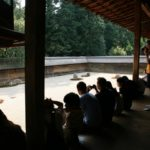 people spending time on a zen garden