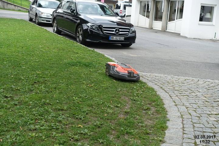 robot lawn mower navigating uneven terrain