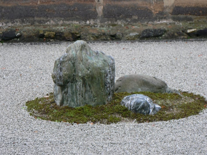 rocks representing islands on a zen garden