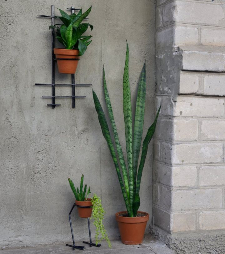 hanging planters on brick wall