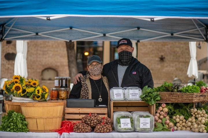 market gardeners in a farm stand